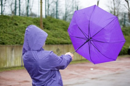 A person holding an umbrella, inside out from the wind. The Spirit works like the wind.