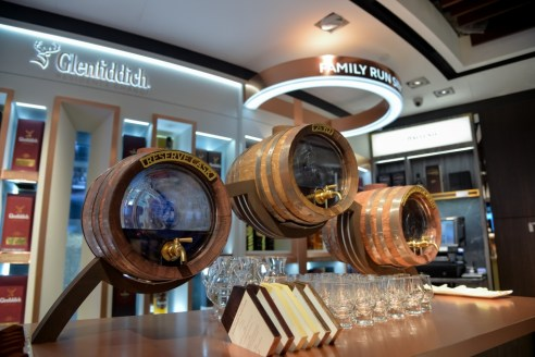 Glenfiddich Scottish Malt presented in elegant beer barrels, encapsulating the themes of Scottish tradition and impeccable class.