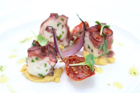 Poached pan-seared octopus chick peas puree red onion sundried tomatoes