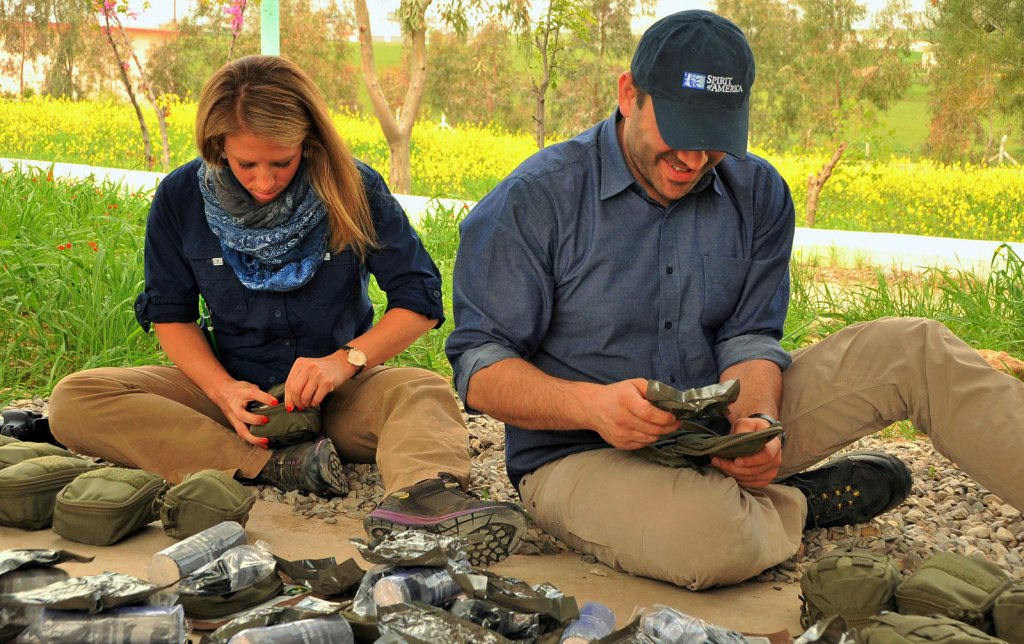 SoA Field Rep's – Nicholette and Zack assemble the medical kits for distribution