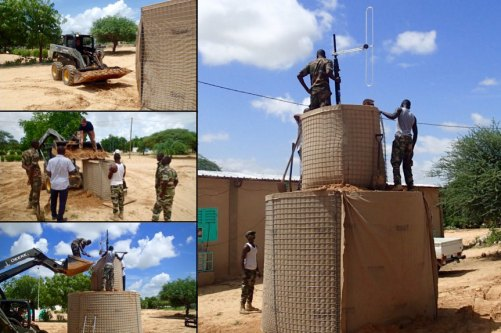"""Members of the FAN and their US Advisors work to construct the radio broadcast antenna at the Headquarters of """"Radio Bouclier"""" – in English, """"Radio Shield"""" – in Diffa, Niger"""