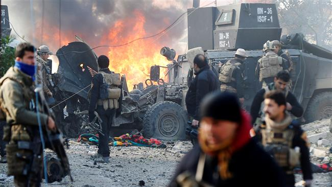Iraqi Special Operations Forces (ISOF) react after a car bomb exploded during an operation to clear the al-Andalus district of ISIS militants, inMosul, Iraq, January 16, 2017. (Courtesy of Press TV)