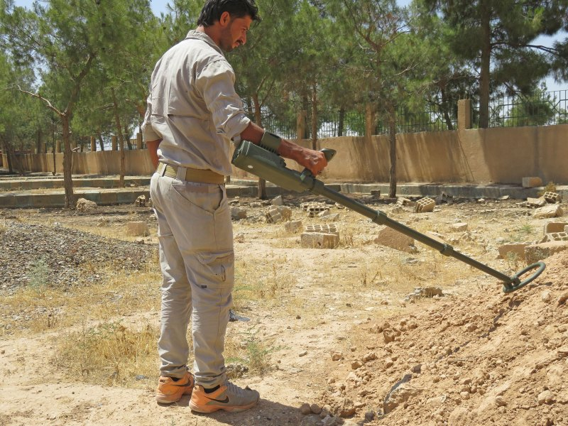 RMCO technician uses a metal detector to locate landmines in Syria