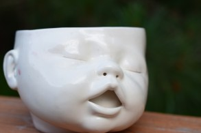 Creepy baby face planter