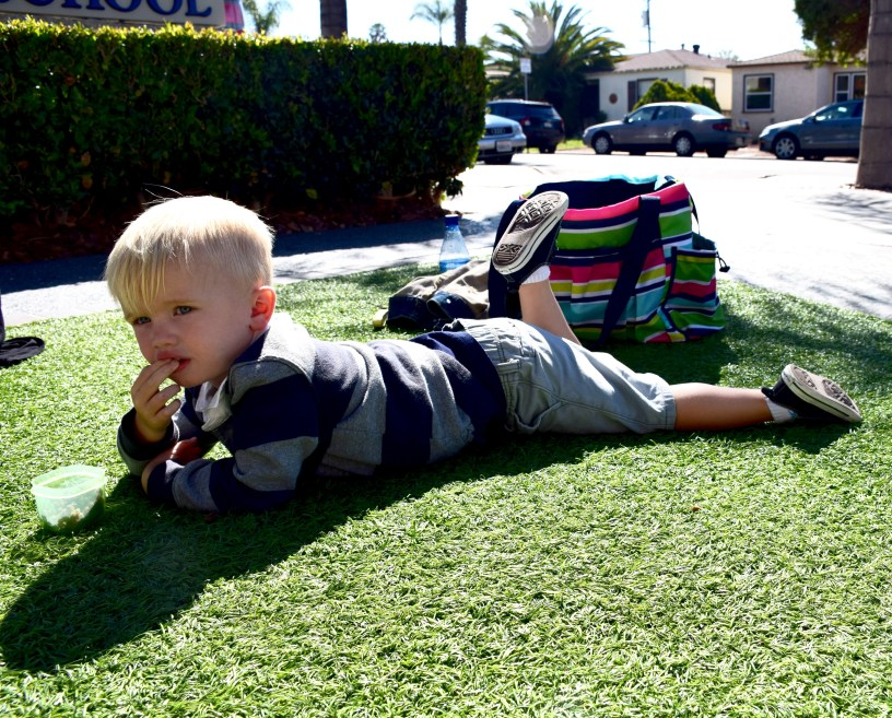 Lounging on the grass enjoying a meal after swim class