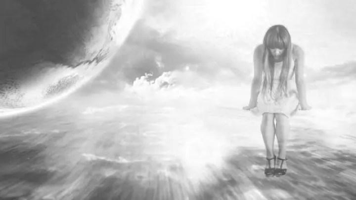 うなだれる女性 地球 神秘 光
