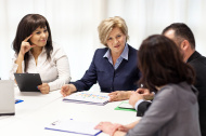 stock-photo-57841140-group-of-professionals-at-business-meeting