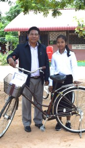 Kim and Sarin stand with her bike