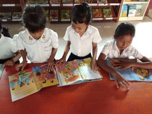 students reading the new books
