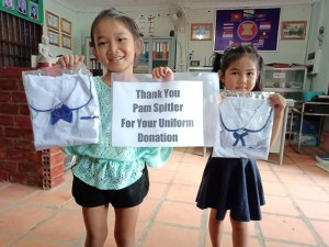 students with their new uniforms