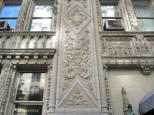 According to the plaque on the side, this building is the Alwyn Court Apartments, a designated NYC landmark.