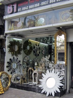 My favorite mirror is the one behind the sunburst at the bottom right. The pegasus is so awesome... and yet so tacky.