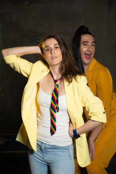 Two people dressed in yellow