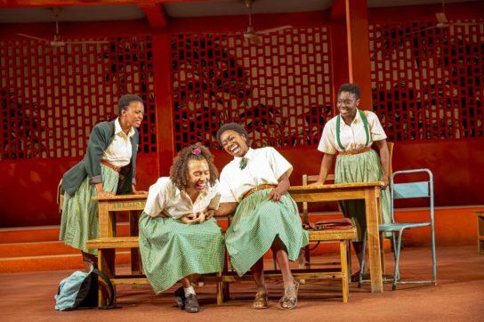 Four girls laughing