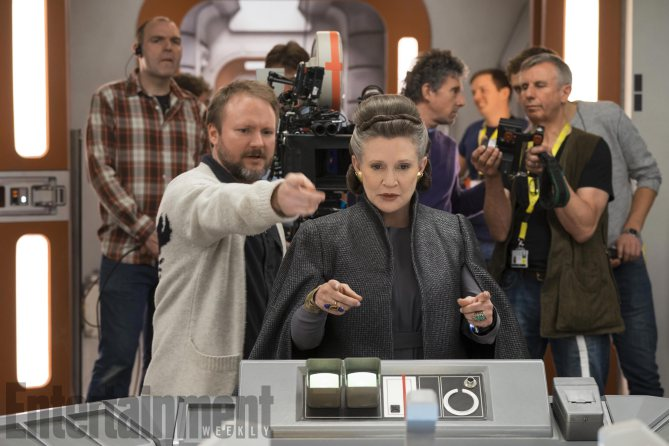 L to R: Director Rian Johnson with Carrie Fisher (Leia) on set