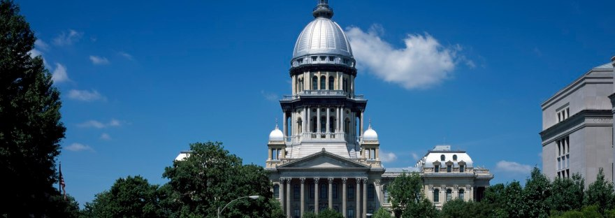 The exterior of the Illinois capitol building on a sunny day