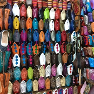 Babouches galore and other leather goods of the souk, Marrakech, Morroco…
