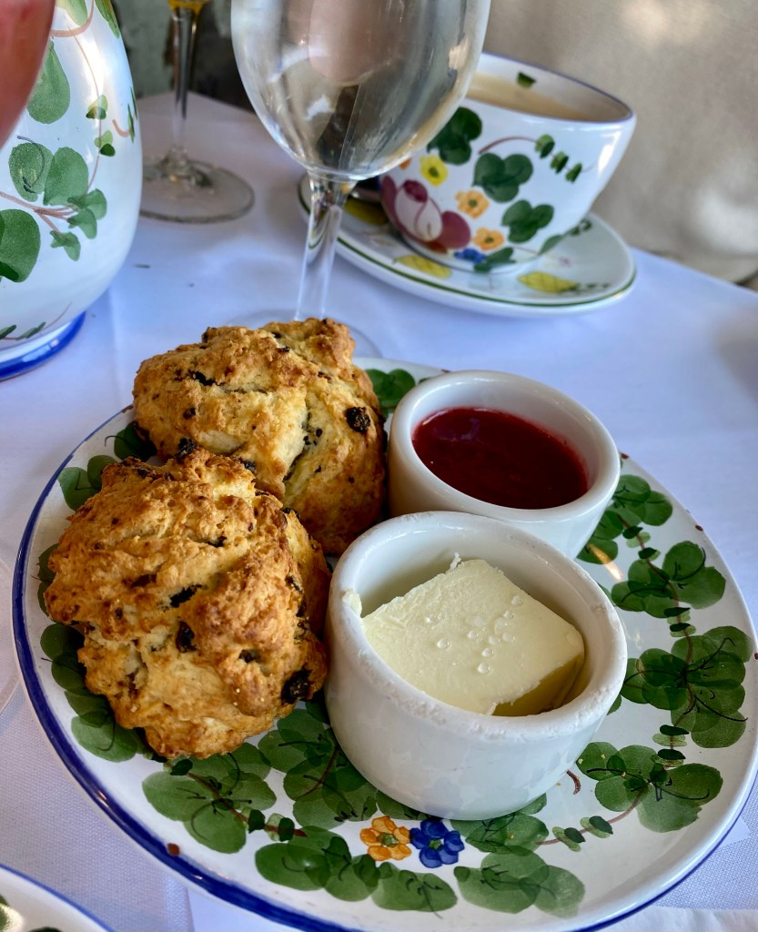 crunchy scones, butter, homemade strawberry jam, hand painted dishes