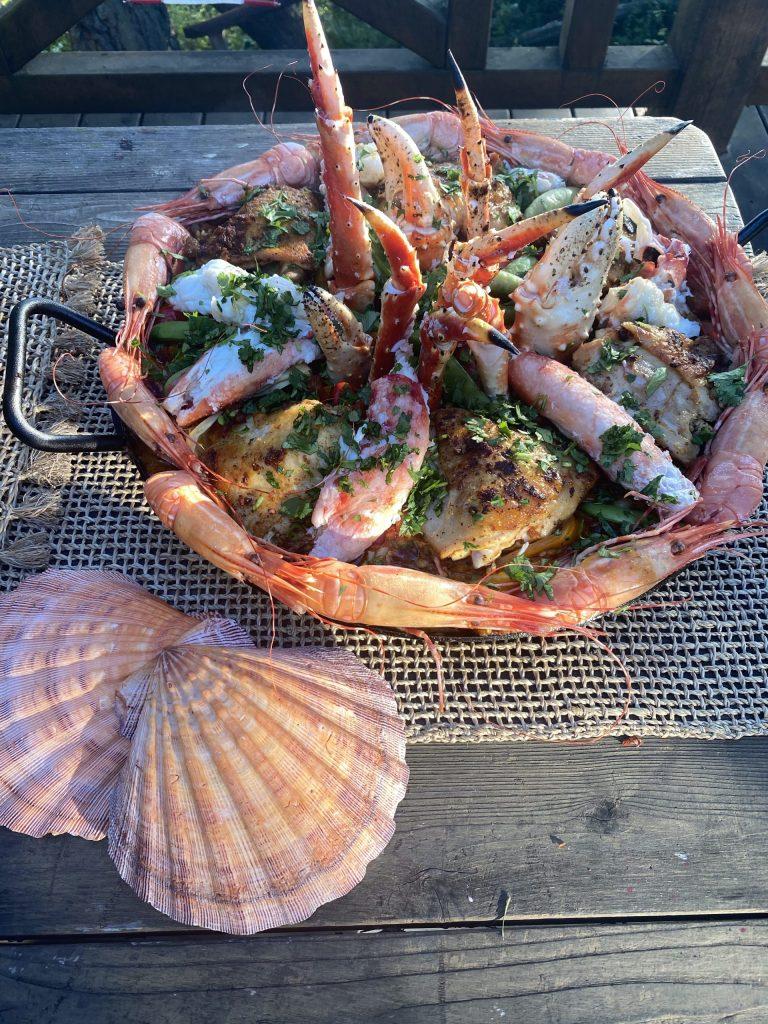 Paella, master paella recipe, spot prawns, saffron, Spanish saffron, Alaska king crab, chicken thighs, chorizo sausage, bomba rice, sweet peppers, olives, capers, artichoke hearts, sugar snap peas, Spanish olives, parsley, scallop shell servers