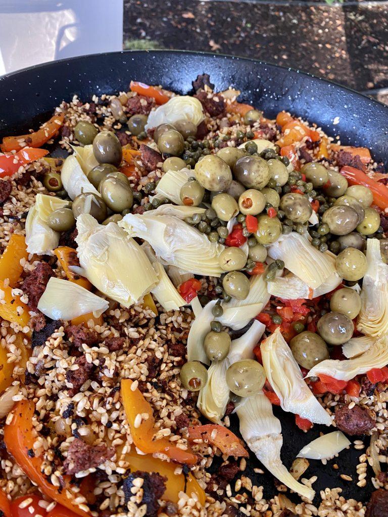 Paella, master paella recipe, bomba rice, sweet peppers, olives, Spanish olives, chorizo sausage, capers, artichoke hearts,