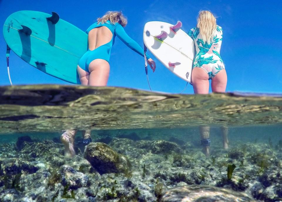 Girls going surfing in bikinis half half photo
