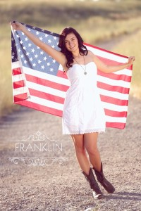 High School Senior girl with american flag during senior photo session with franklin photography studio.