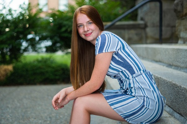 Cute senior photo of redhead girl in downtown Spokane