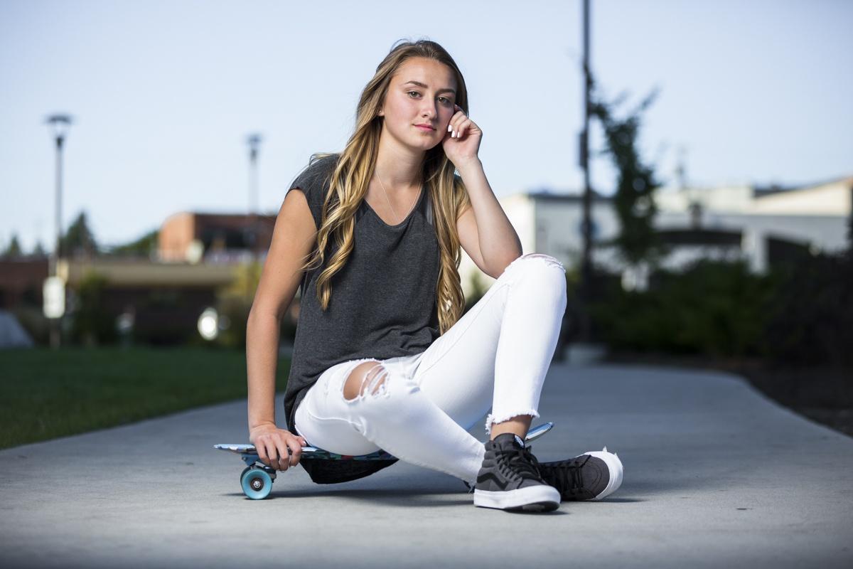 photography of a high school girl on a skateboard