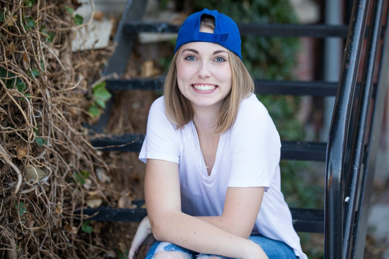 Senior portrait of girl with hat