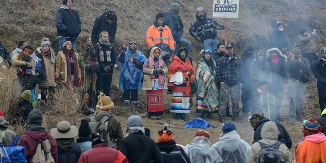 Protesters participate in a prayer circle on Turtle Island on Thanksgiving day during a protest against plans to pass the Dakota Access pipeline near the Standing Rock Indian Reservation, near Cannon Ball, North Dakota, U.S. November 24, 2016. REUTERS/Stephanie Keith - RTST7EJ