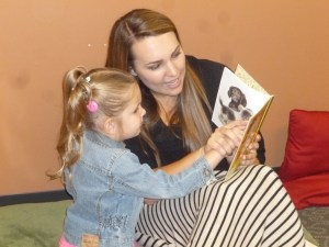 Lindsay, teacher, reading with a student.