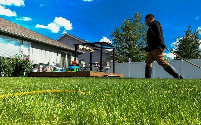 A Spokane's Finest Lawns employee preparing to start a lawn fertilization treatment.