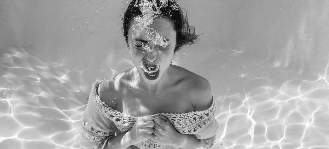 anonymous woman screaming underwater