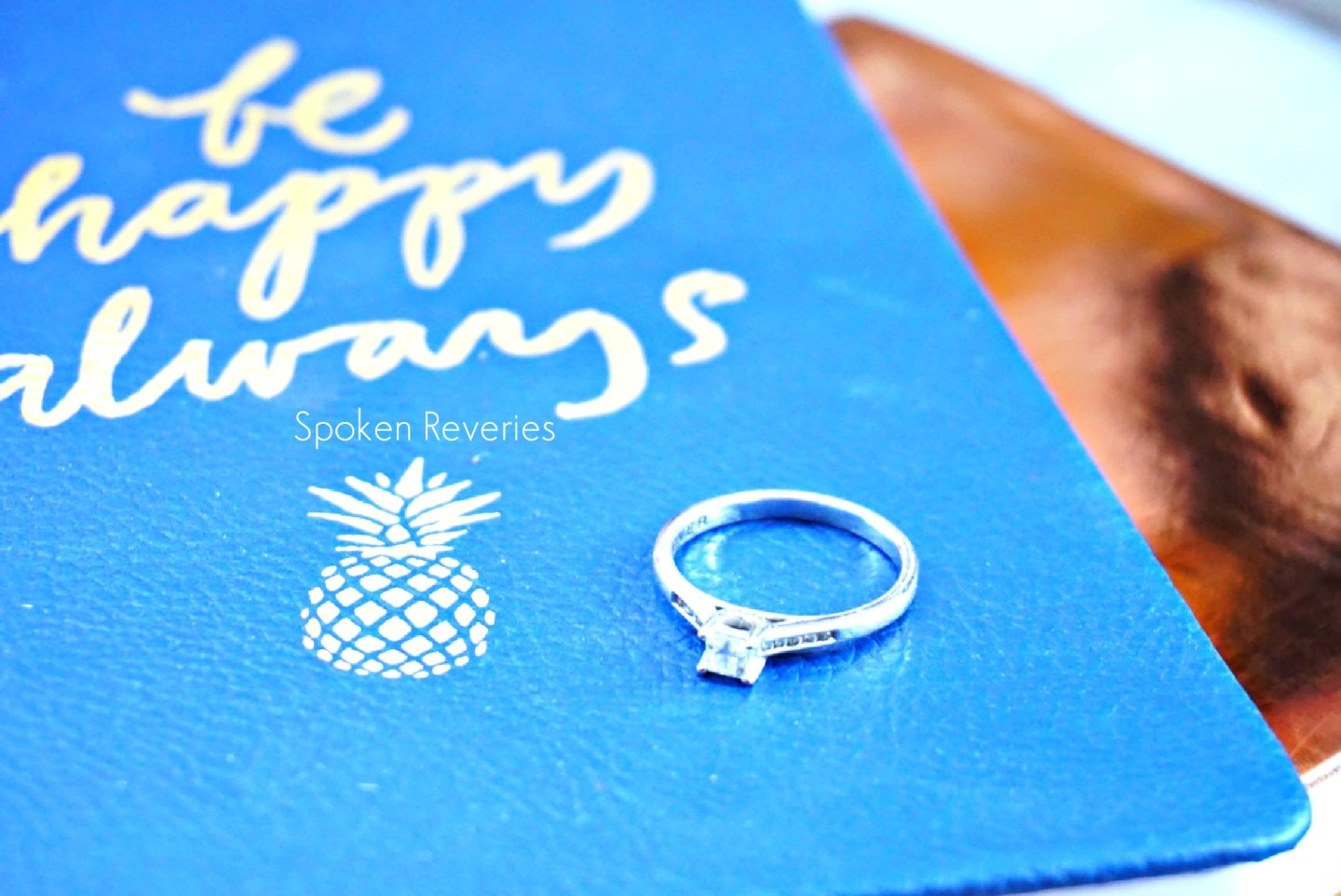 Engagement ring on notebook
