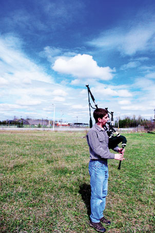Joshua Christie, an electrical engineering technology student, practises playing the bagpipes in an empty field beside Pino's Pizza when the weather is nice. Christie plans to compete in the upcoming pipe band competition at the Toronto Indoor Highland Games on April 14.