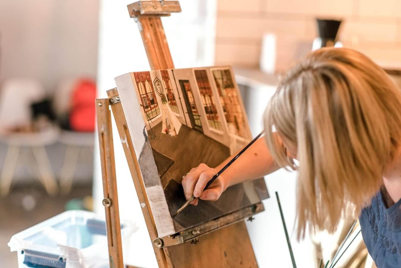 Artist Emily McDougall paints.