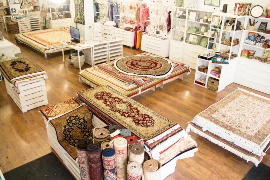Handmade rugs fill the Ten Thousand Villages Waterloo showroom in May 2018