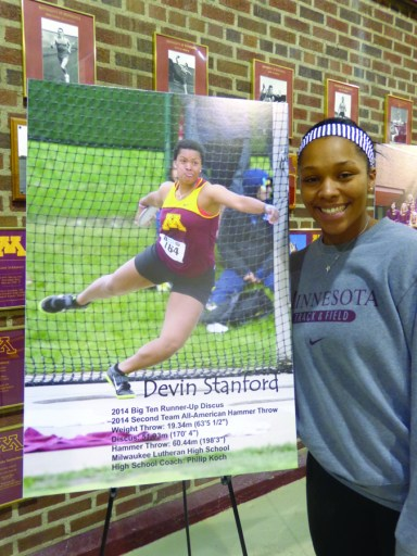 Devin Stanford with a photo of herself in action