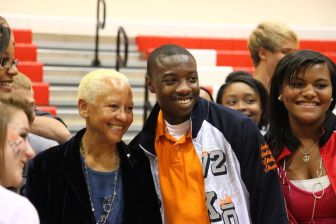 HistoryMaker Nikki Giovanni poses for photos with students as part of Back to School Day.