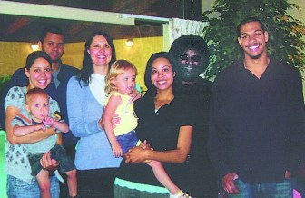 Makolle Williams, second from right. with members of his family (l-r) son Javan, oldest daughter Nicole holding grandson Dawson, wife Beth holding granddaugther Macy, daughter Azzahya and son Aaron.