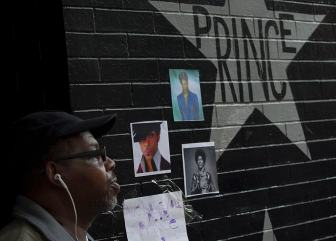 A fan honoring Prince outside of First Ave.