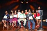 Scholarship winners (l-r): Aamira Redd, Amia Bridgeford, Jamani Buckner, Brandon Banks, Praise Hall. Background: MSR Publisher/CEO Tracey Williams-Dillard (left) and emcee Shed G.