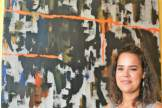 ROHO Collective painter, Stephanie M. Gandy shows off her painting