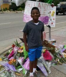 Andrew Brundidge at the makeshift memorial for Philando Castile in Falcon Heights