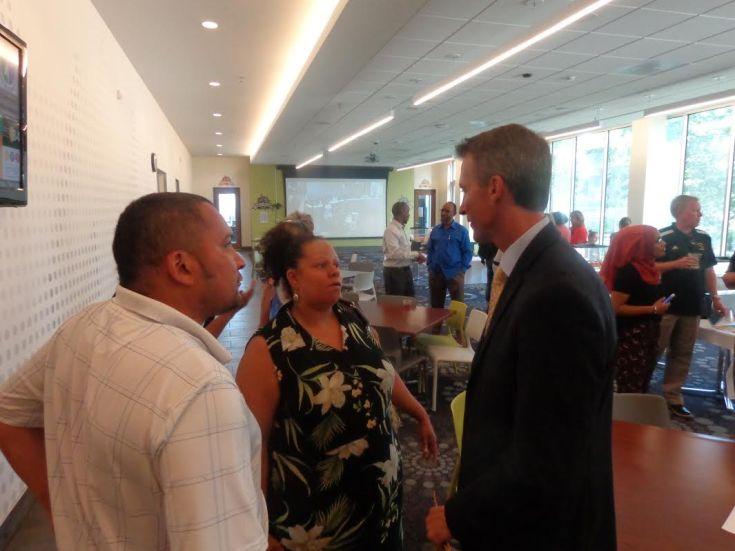 Ira Jourdain, meeting attendee, with Kerry Jo Felder and MPS Superintendent Ed Graff