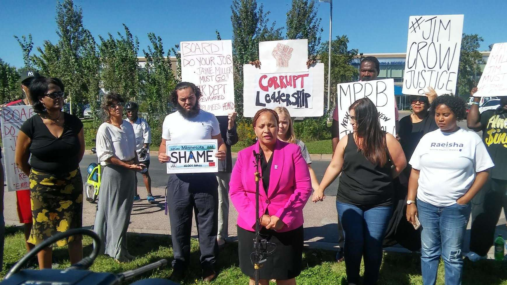 (l-r) Cathy Jones (at microphone), Davina Newman (behind Jones), Emily Flower, and Raeisha Williams along with other attendees of the September 8 press conference. Photo by Charles Hallman