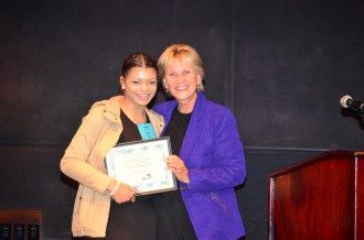 Cecil E. Newman scholarship recipient Alicia Harper accepting her plaque at the 2017 Graduation Celebration
