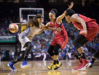 Lynx guard Seimone Augustus (with ball)