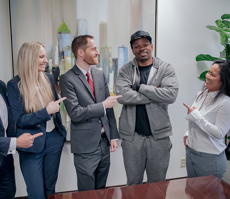 Some of the Spolin Law attorneys and staff celebrate with the client days after he is released from prison. Pictured (left to right): Caitlin Dukes (attorney), Aaron Spolin (attorney), R.H. (client), Hemi Tann (Case Manager).