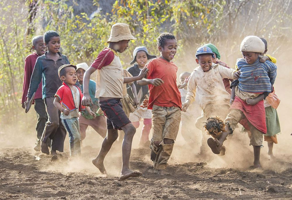 Kids playing football in Madagascar • spoly